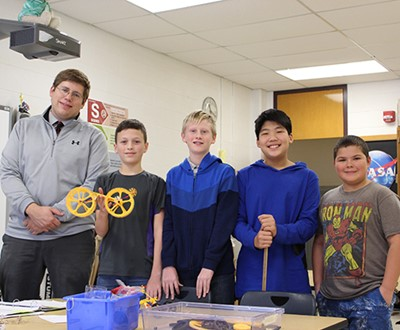 Students use engineering principles to break rubber band car world record
