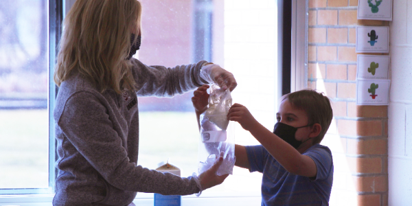 Teacher Daneen Williams helps student make ice cream