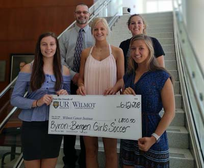 Team donates $1,800 to Wilmot Cancer Center