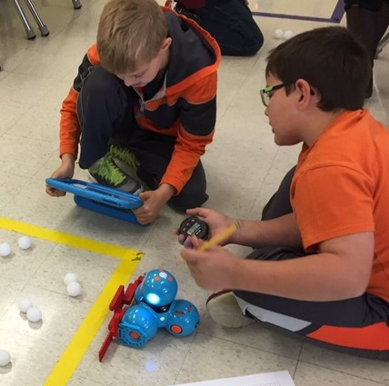 Inquiry Lab students making a pumpkin picker robot.