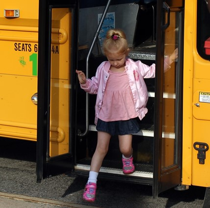 ES student getting off bus.
