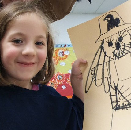 ES girl with drawing of scarecrow.