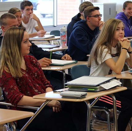 HS students in classroom.