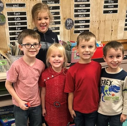 Group of smiling first-graders.