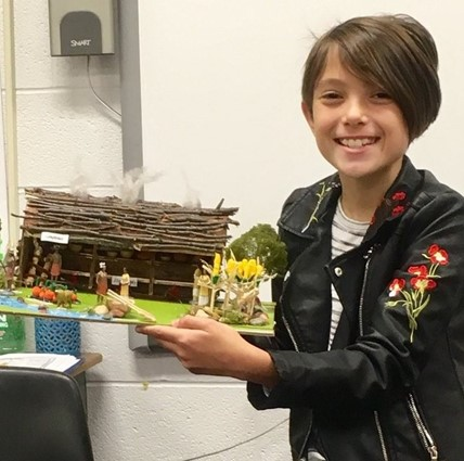 Student showing her Native American project.
