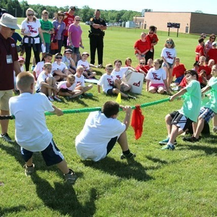Tug of war outside during Olympics Day at the Elementary School.