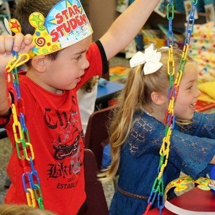 Elementary School children with colorful link chains.