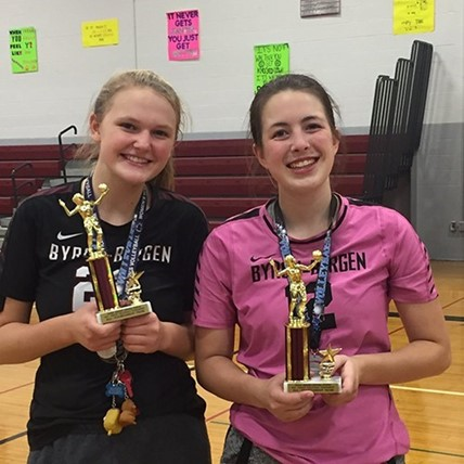 Volleyball players with trophy