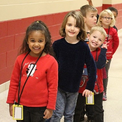 Kids in hallway dressed for red ribbon week