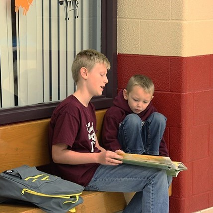 Two students read together