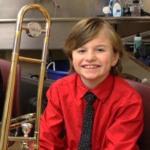 student with trombone