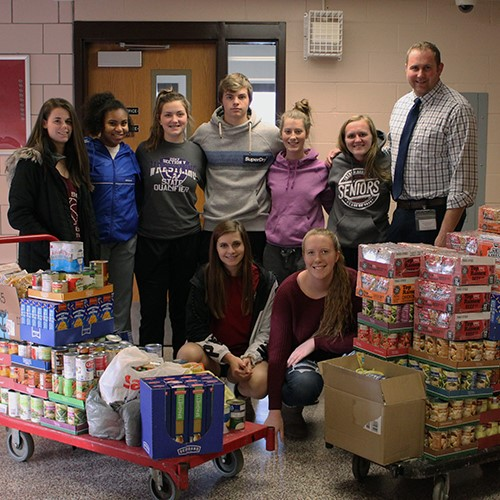 Varsity Club delivers canned food