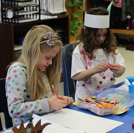 Students working together on the 100th day of school.