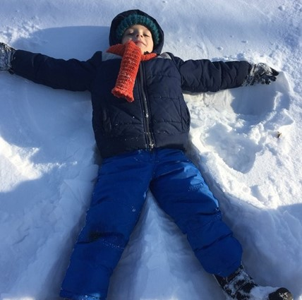 ES student making a snow angel.