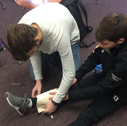 Students practicing first aid at the Jr./Sr. HS.
