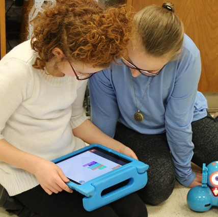 Two 4th-graders working in the Learning Lab.