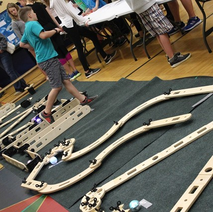 Miniature golf course with robots at Science Fair.