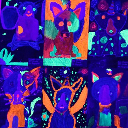Art in the black light room at the Art Show.