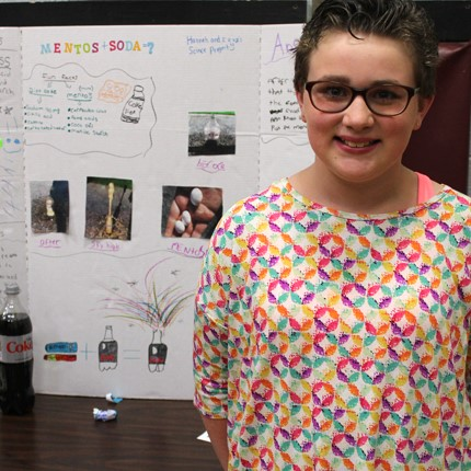 Student with Science Fair project.