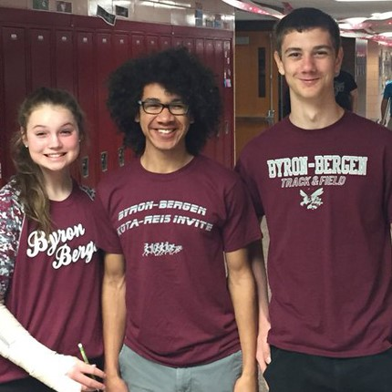 Three students celebrating Spirit Week.