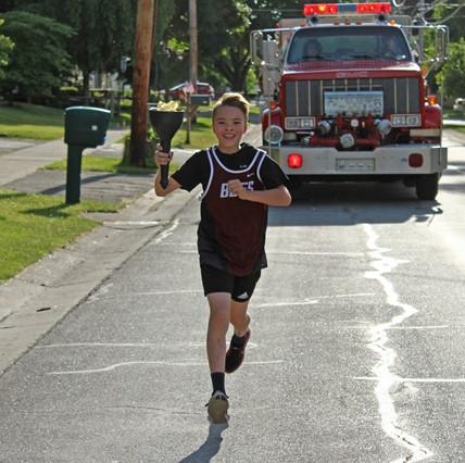 Varsity runner for Torch Run.