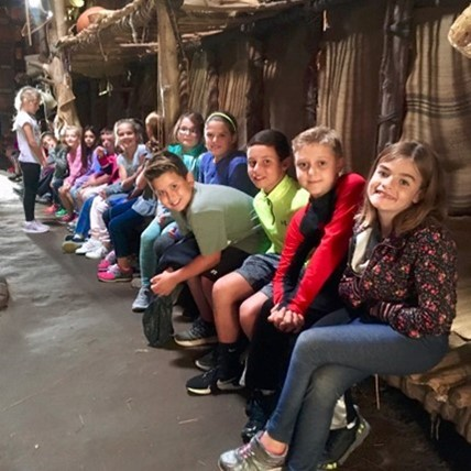4th graders in longhouse replica