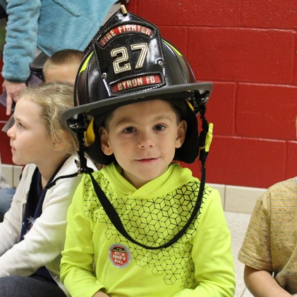 student with fire helmet