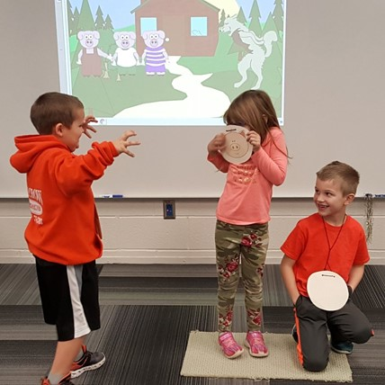 students act out 3 Little Pigs in music class