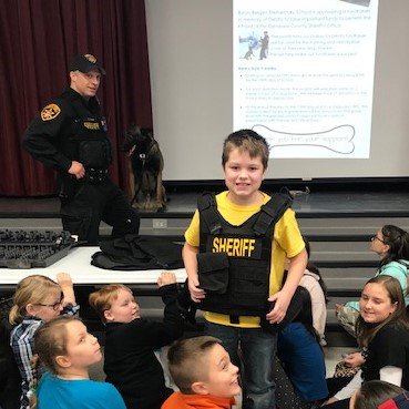 student in Sheriff vest