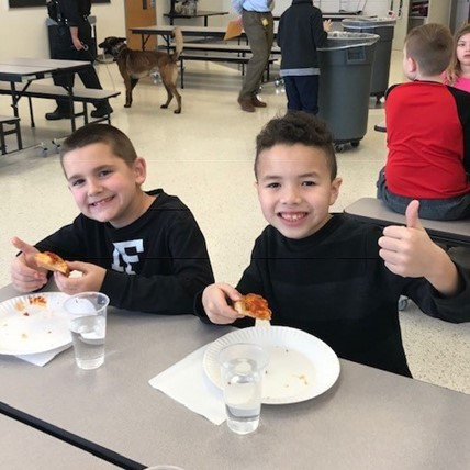 students at pizza party