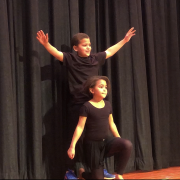 students perform at assembly