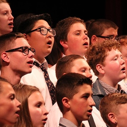 students sing at chorus concert