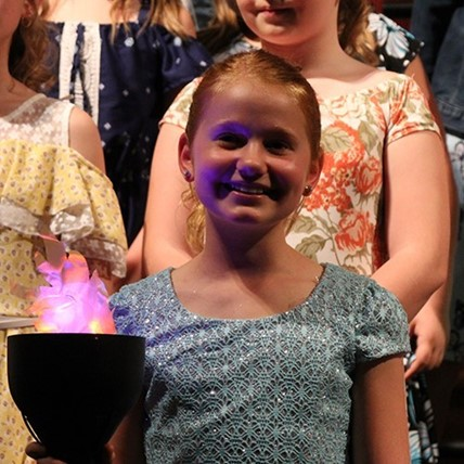 4th grader with torch