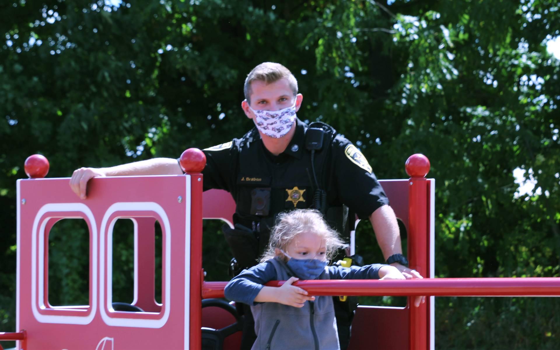 Deputy Brabon with students on playground
