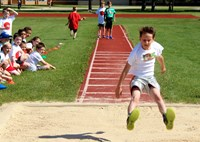 Elementary School students using one of the athletic fields.