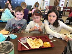Elementary School students in the cafeteria.
