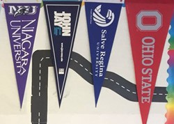 College flags in the hallway.
