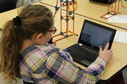 Elementary School student using notebook computer.